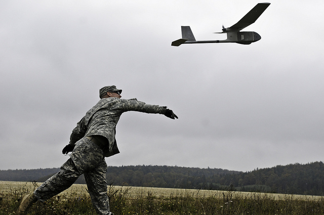 Sgt. Jason E. Gerst, a Virginia Beach, Va., native, now a squad leader with 2nd Platoon, A Company, 2nd Battalion, 18th Infantry Regiment, 170th Infantry Brigade Combat Team, launches the RQ-11B Raven unmanned aerial vehicle during Raven training here, Oct. 5.